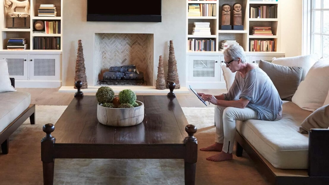 A view of a Royal Bank of Scotland (RBS) customer sits in her home using a tablet to access her account